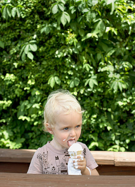 Boy (2-4) eating ice cream