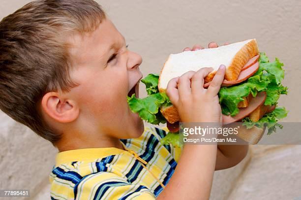Boy eating monster sandwich