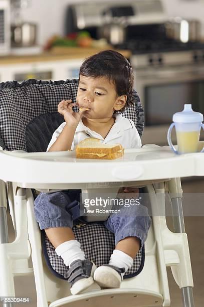 Boy eating peanut butter sandwich