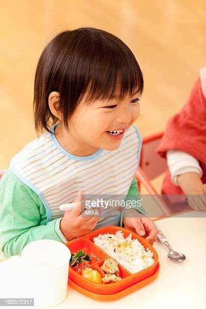 Boy Eating School Lunch