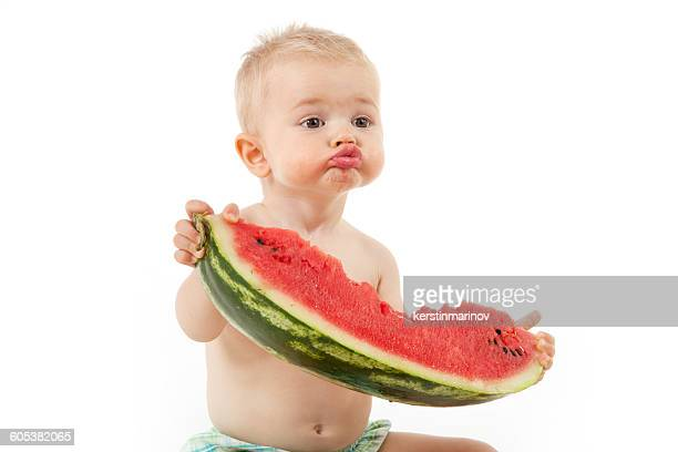 Boy eating slice of watermelon