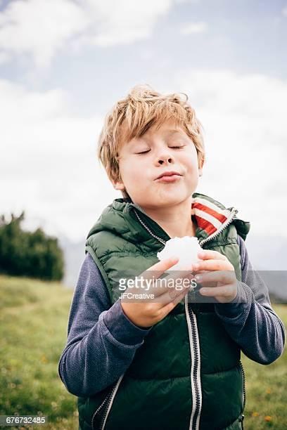 boy eating snow