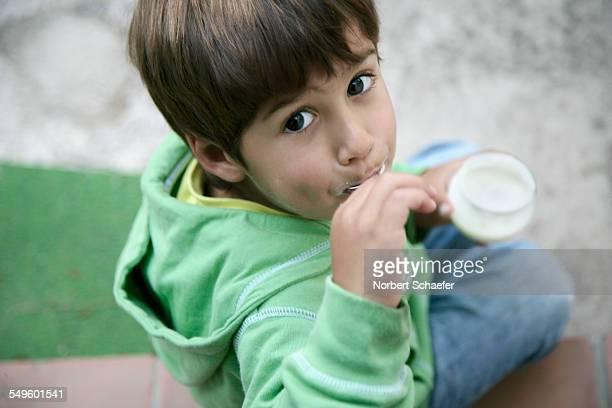 Boy Eating Yogurt