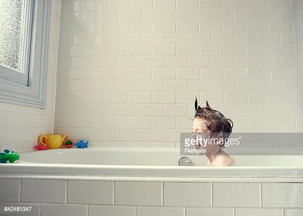 Boy enjoying a bath