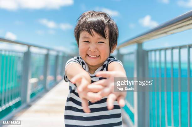 Boy enjoying at Guam and a pier with a view of the sea