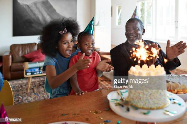 boy enjoying birthday party with family at home - happy birthday images for sister stock pictures, royalty-free photos & images