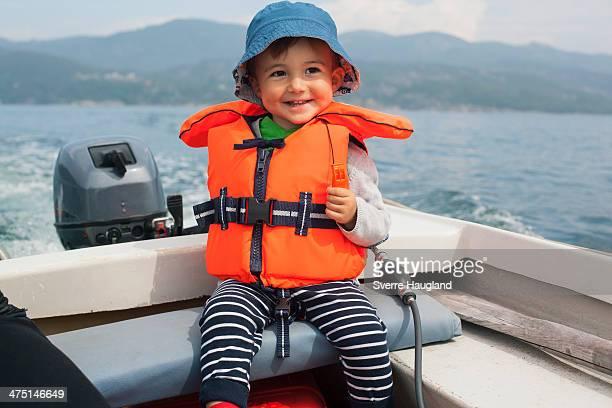 boy enjoying boat ride - life jacket stock pictures, royalty-free photos & images