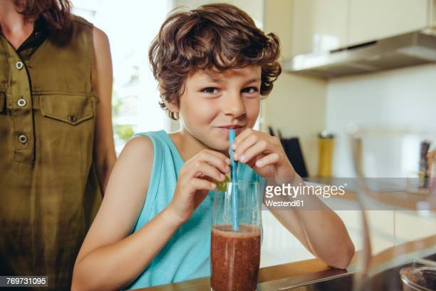 Boy enjoying his homemade smoothie