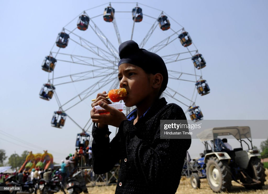 A boy enjoying ice candy on the occasion of Baisakhi festival on April 13 2017 in Patiala India Baisakhi is a historical and religious festival in...