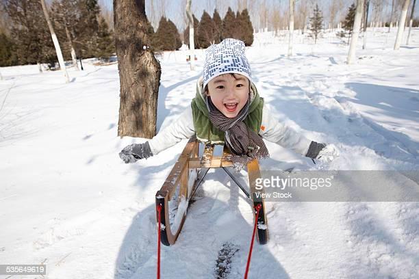 Boy enjoying in the snow