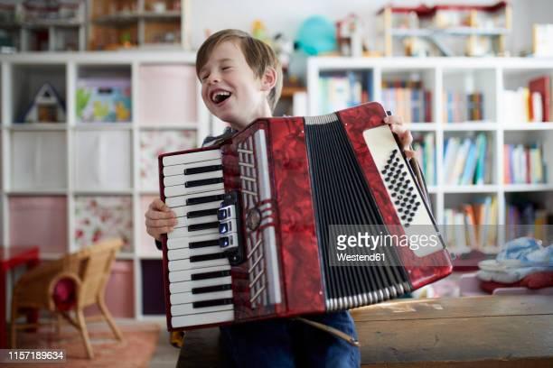 boy exercising on his accordeon - singen stock-fotos und bilder