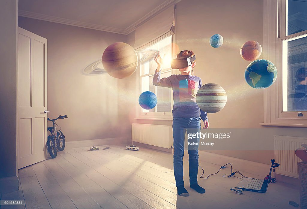 Boy explores virtual reality solar system : Stock Photo