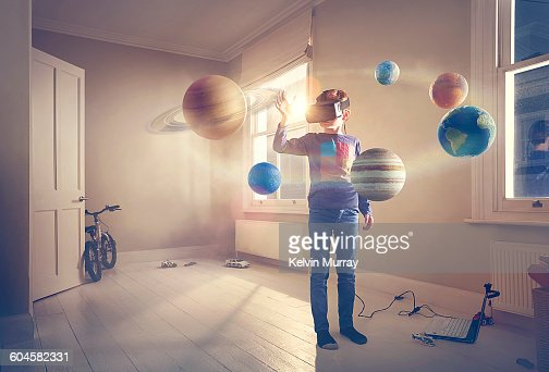 Boy Explores Virtual Reality Solar System Stock Photo