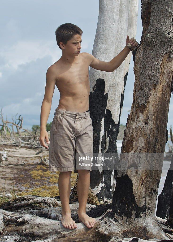 Boy Exploring Island On Deserted Beach Stock Photo | Getty ... - photo#32