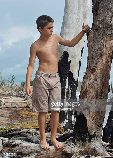 Boy Exploring Island on Deserted Beach