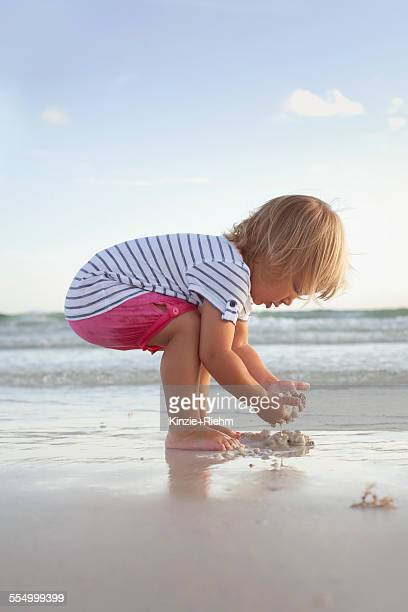 Boy exploring on the beach at sunset