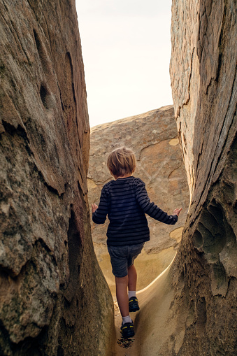 Boy exploring slot canyon, Santa Barbara, California, United States - gettyimageskorea