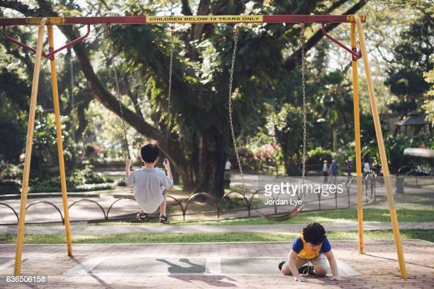 Boy fall down from Swing