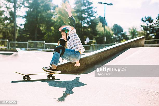 boy falling off skateboard at skate park - falling stock pictures, royalty-free photos & images