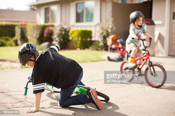 Boy falls off bike