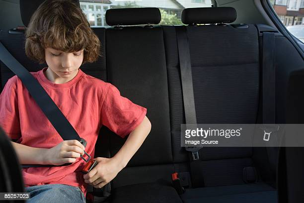 Boy fastening his seatbelt