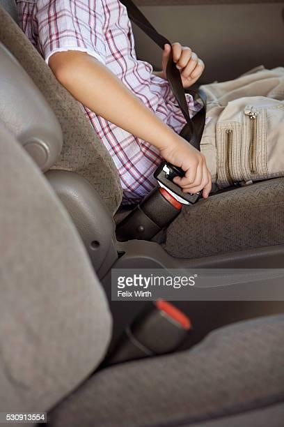 Boy fastening safety belt