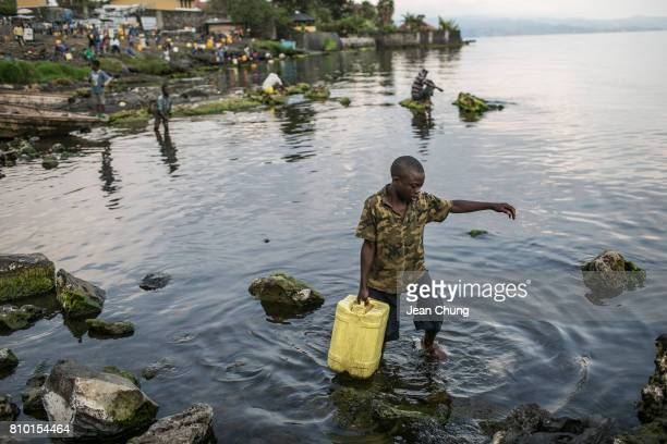 A boy fetches water directly from the Kivu Lake If the residents come to the lake and fetch the water they do not pay for the water and a worker from...