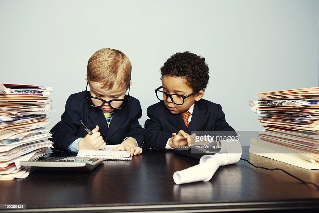 Boy Financial Advisors Add Numbers on Calculator : Stock Photo