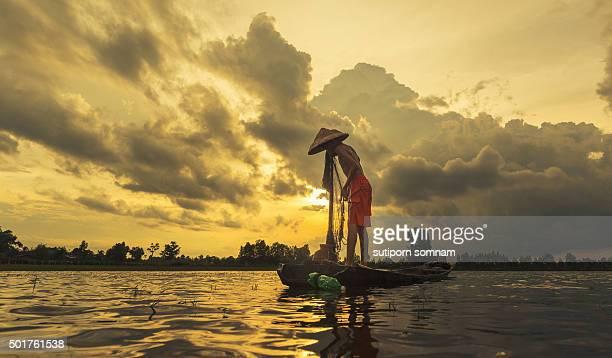 Boy fishermen are catching fish