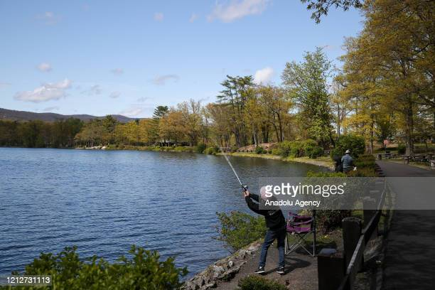 Boy fishes at the Bear Mountain state park which is seen quite during Covid-19 pandemic in New York, United States on May 11, 2020.