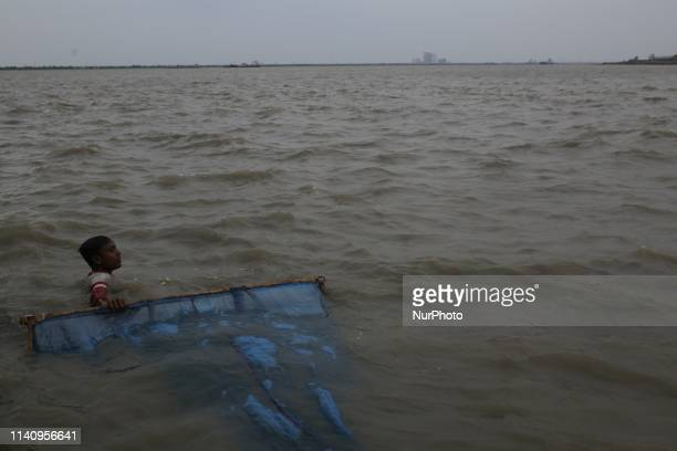 A boy fishing in the Pashur river at Dakop in Khulna as Cyclone Fani approaching towards Bangladesh on May 3 2019 At least eight people have killed...