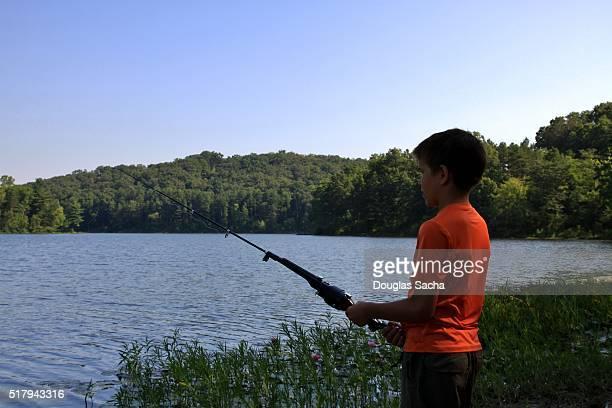 Boy fishing on the shore, Lake Hope State Park, McArthur, Ohio, USA