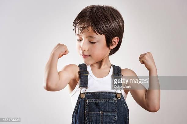 Boy flexing muscles