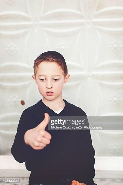 Boy flipping penny
