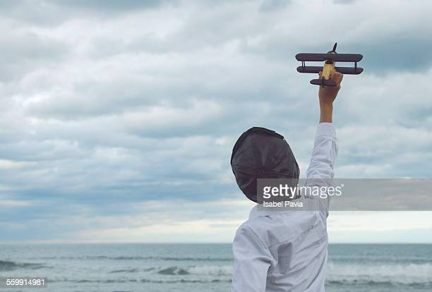 Boy flying a toy plane