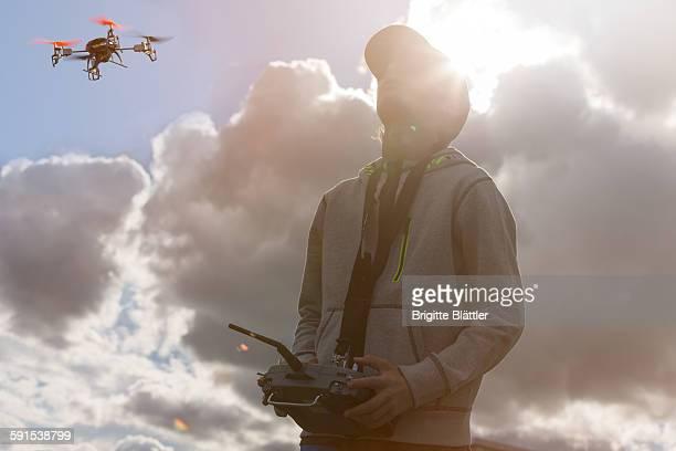 Boy flying drone in Switzerland