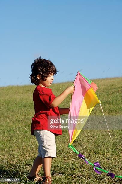 Boy flying kite at Sydney Park.