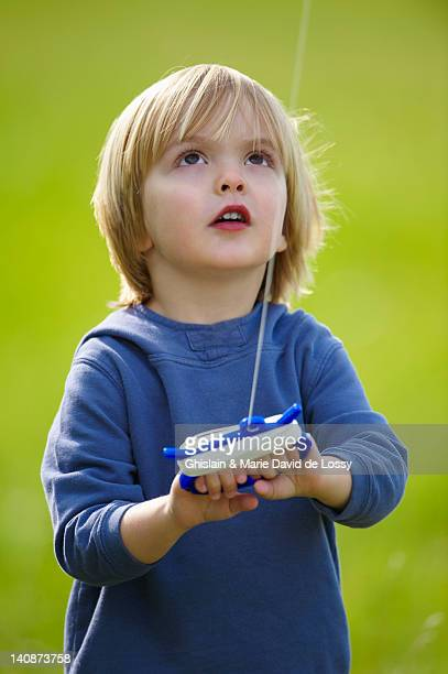 boy flying kite outdoors - saint ferme stock pictures, royalty-free photos & images