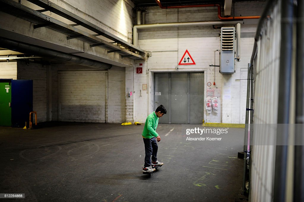 A boy from Afghanistan skates through corridors inside a shelter where they live while their asylum applications are processed on February 25, 2016 in Sarstedt, Germany. Germany received approximately 1.1 million newcomers in 2015 and is now facing the arduous task of processing asylum claims and taking steps to integrate those whose applications are accepted.