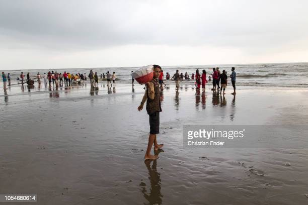 Cox´s Bazar Bangladesh October 14 2018 A boy from Bangladesh a street vendor who has to do child labor is posing into the camera at the beach The...