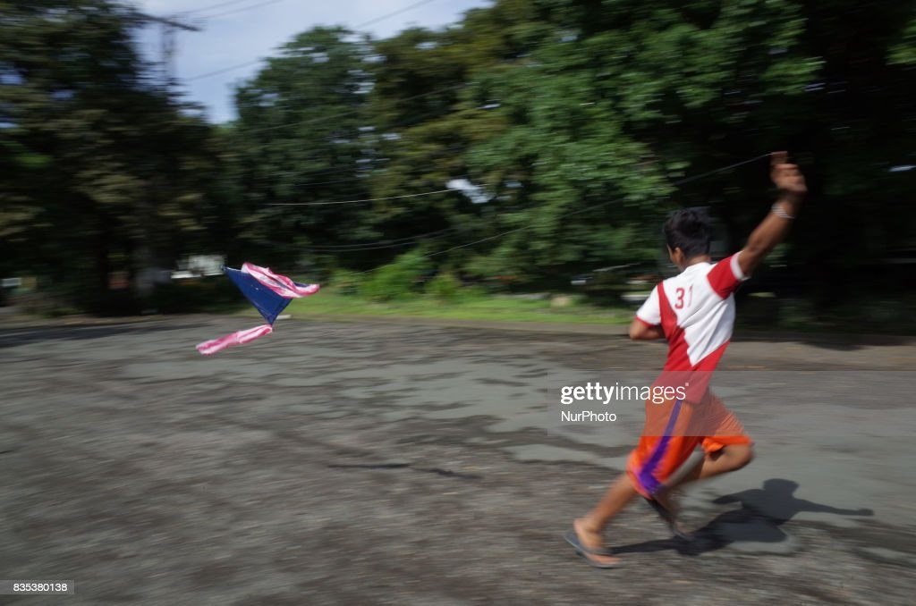 A boy from Mindanao residing at a makeshift school at the University of the Philippines International Center flies a kite in Quezon City on Saturday, August 19, 2017. In a statement, the Save Our Schools Network, an organization facilitating the shelter of 'lumad' refugees at the University of the Philippines campus, challenged the National Commission on the Indigenous Peoples (NCIP) to 'support their fellow lumad's aspirations to have a school rather than be a tool for counter-insurgency.' President Rodrigo Duterte has previously stated that he will bomb indigenous peoples' schools, accusing them of teaching rebellion to indigenous children.