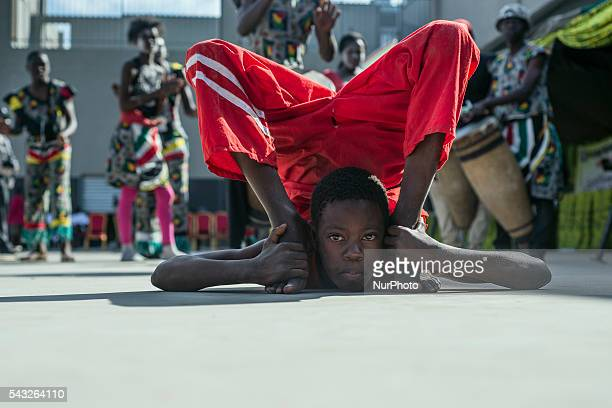 A boy from Njovu Acrobatics makes a trick during the performance dedicated to International Day against Drug Abuse and Illicit Trafficking in Lusaka...