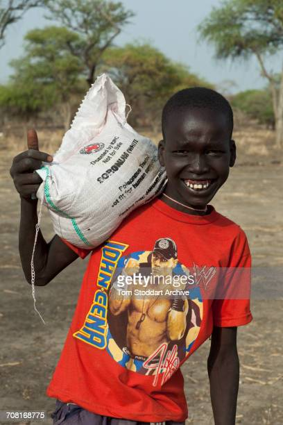 A boy from Nyintar village photographed during an International Committee of the Red Cross distribution of seeds agricultural tools and food staples...