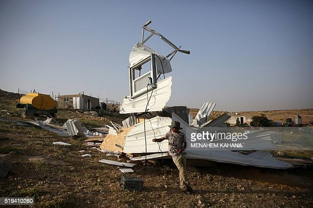 TOPSHOT A boy from the Arab Jahalin Bedouin community stands next the rubble of his home in the village of Umm alKheir south of the West Bank city of...