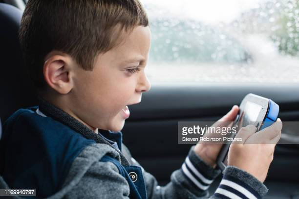 boy frustrated playing games console - portability stock pictures, royalty-free photos & images