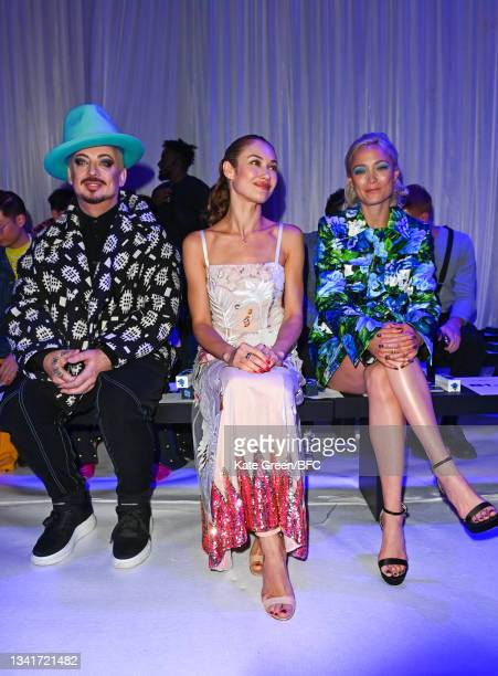 Boy George, Olga Kurylenko and Pom Klementieff attend the Richard Quinn show during London Fashion Week September 2021 on September 21, 2021 in...