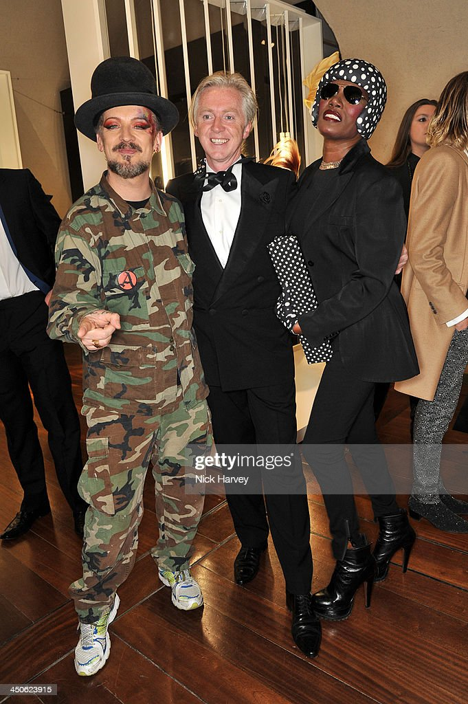 Boy George, Philip Treacy and Grace Jones attend the private view of Isabella Blow: Fashion Galore! Party at Somerset House on November 19, 2013 in London, England.