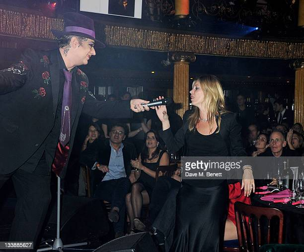 Boy George sings to winning bidder Kate Moss at The Hoping Variety Show A Benefit Evening For Palestinian Refugee Children at Cafe de Paris on...