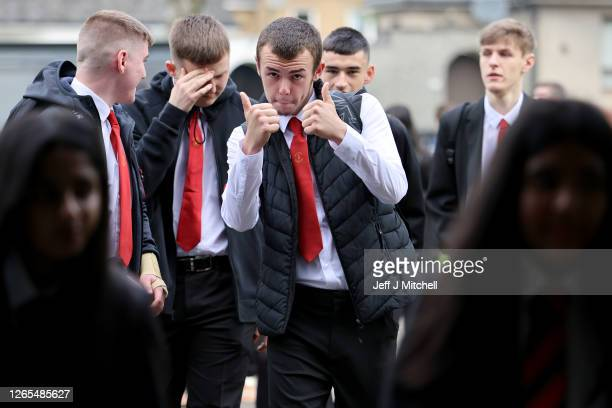 Boy gestures to the camera as pupils return to St Paul's High School for the first time since the start of the coronavirus lockdown nearly five...