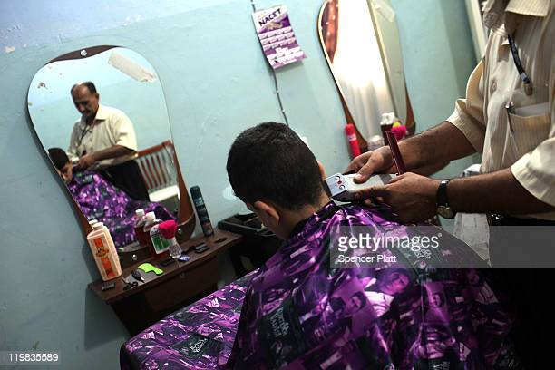 Boy gets a haircut at the Al-Baraum orphanage on July 25, 2011 in Baghdad, Iraq. The state owned orphanage has about 50 children currently with the...